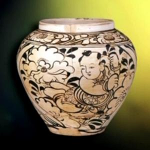 元磁州窑白釉黑花婴戏图罐